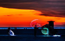 People With Hula Hoops On The Beach, Sunset, Clouds, Orange, Red, Siesta Key, Florida