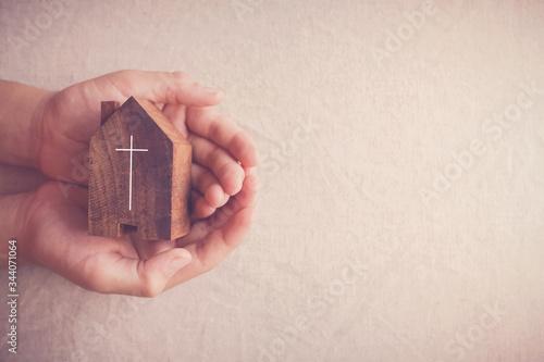 Fotografia, Obraz Child hands holding church, serving God, praying hands, home church service duri