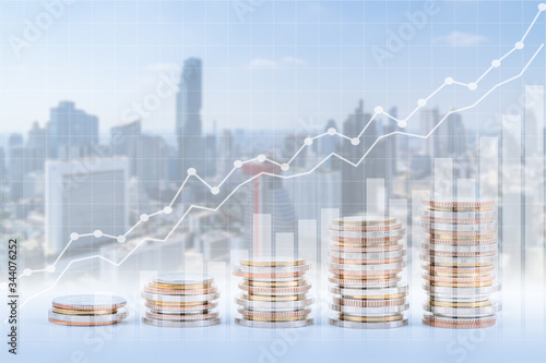 Fotografía Finance, banking, and investment concept, double exposure of coins stack and city, with growing trend graph
