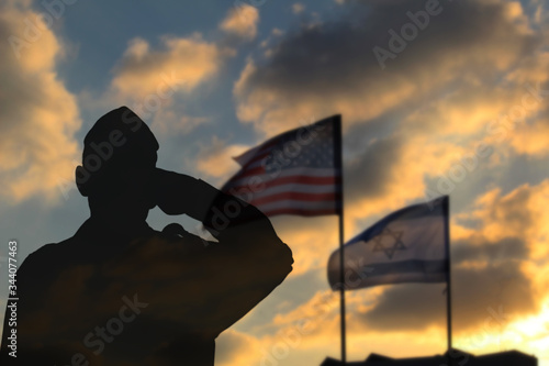 Slika na platnu Silhouette of a soldier against the backdrop of the US flag and the flag of Israel