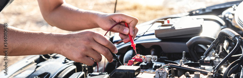 Photo Mechanic repairman checking engine automotive in auto repair service and using d