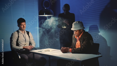 Suspected mixed-race man signing a document of accusation Canvas Print
