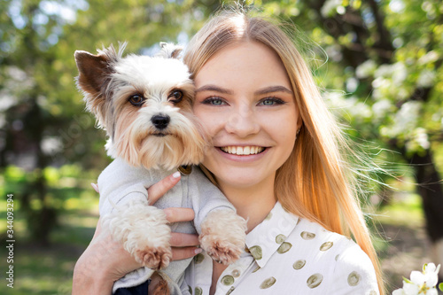 Fotografía Large portrait of a beautiful girl with her dog, friendship between dog and man