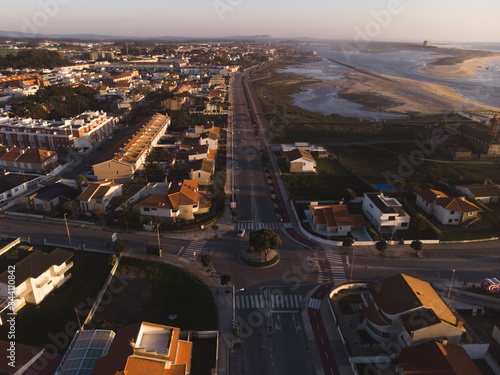 The marginal riverside, along the mouth of the Cavado River at sunset in Esposende, Portugal Wallpaper Mural