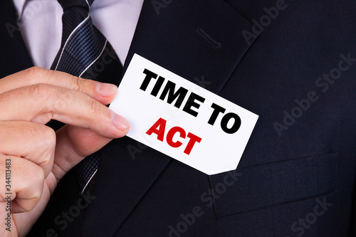 Photo Businessman put card with text Time To Act in pocket