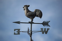 Low Angle View Of Rooster Sculpture On Weather Vein Against Sky