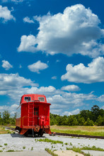 An Old Red Caboose On A Track ...