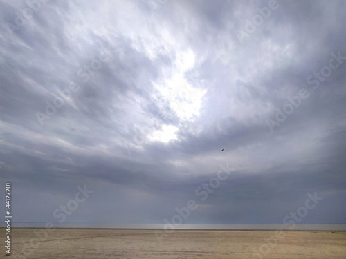 Bottom of the sea, gray day, desert, ambient light, sled, sand, cold, beach, dramatic heaven Wallpaper Mural