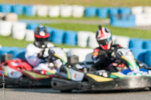 Fotomural Defocused Image Of People During Go-cart Racing