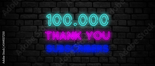 100000 subscribers neon sign on the black wall. Fototapeta