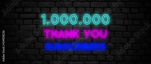 Valokuvatapetti 1000000 subscribers neon sign on the black wall.