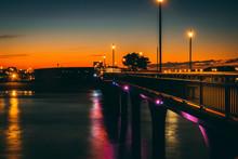 Illuminated Bridge Over River ...