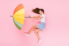 Top Above High Angle View Full Size Profile Side Photo Of Astonished Girl Lay Have Walk Impressed Air Wind Blow Parasol Scream Wear Stylish Clothes Isolated Over Pastel Color Background