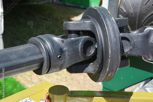 Photo Checking, diagnosing, replacing a universal joint (universal coupling, U-joint, Cardan joint, Spicer or Hardy Spicer joint) axle and driveshaft of a car for bad work or failures