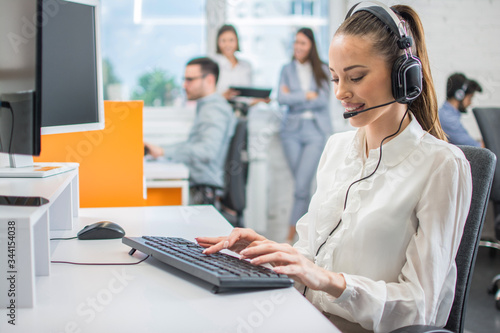 Portrait of female customer support or sales agent Fototapeta