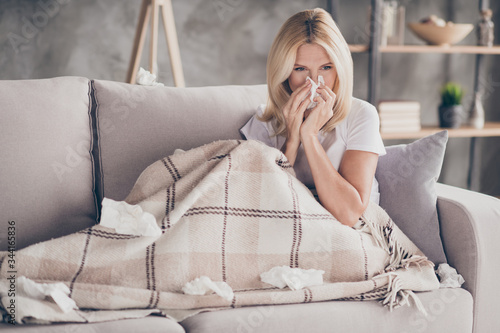 Photo Portrait of her she nice attractive sick mature lady sitting on divan feeling ba