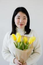 Beautiful Young Asian Woman Ho...