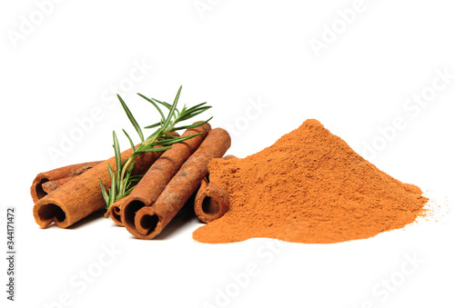 Fotografie, Obraz Cinnamon Sticks and Ground Cinnamon on a white background