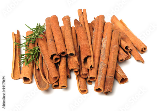 Obraz na plátně Cinnamon and rosemary on a white background