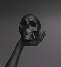 Hand Holding Black Skull Art G...
