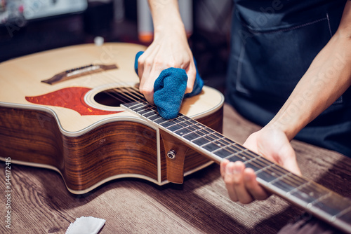 Acoustic guitar repair service, Cleaning the acoustic guitar, Close-up
