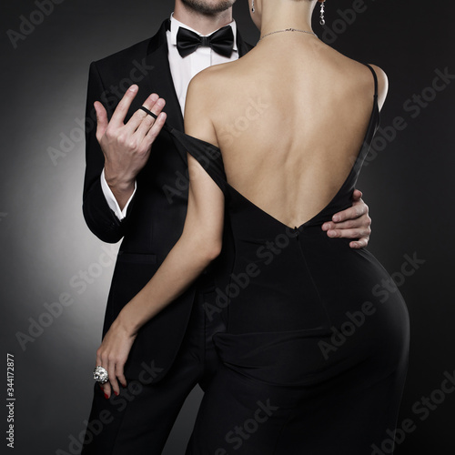 Conceptual photo of sexy elegant couple in the evening suit and dress.