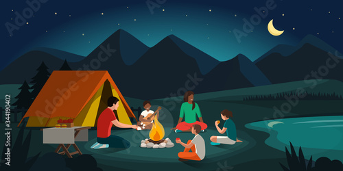 Fotografía Happy family camping in the forest at night