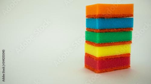Photo multi-colored dish washing sponges on a white background