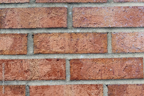 A close view of the red bricks of the brick wall on the building.