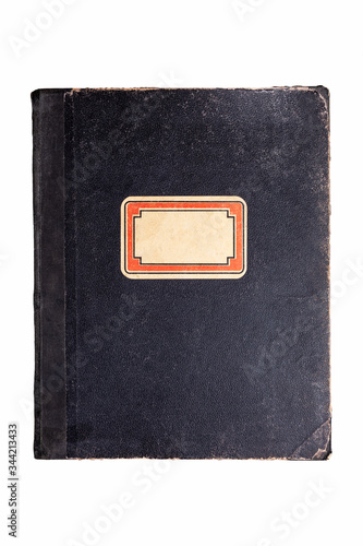 Fotografija Old vintage worn black book, hardback school notebook cover with an empty blank