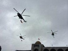 Low Angle View Of Helicopters Flying In Sky