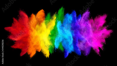 Photo colorful rainbow holi paint color big  double powder explosion isolated dark black wide panorama background