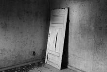 Broken Wooden Door In Abandoned Building