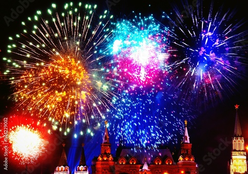 Low Angle View Of Fireworks Over Illuminated Building Against Sky At Night #344229002