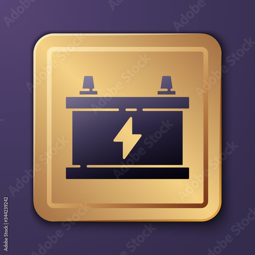 Purple Car battery icon isolated on purple background Canvas Print