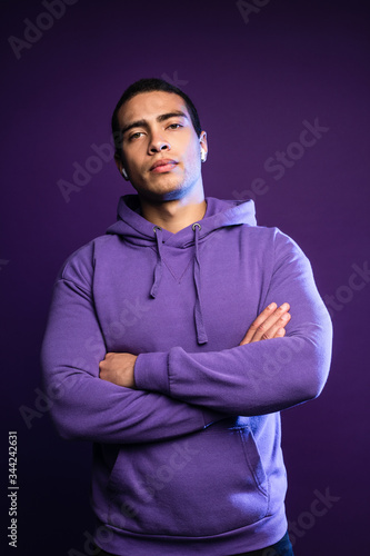 Portrait of young beautiful serious man standing with his hands crossed over his chest Fototapeta
