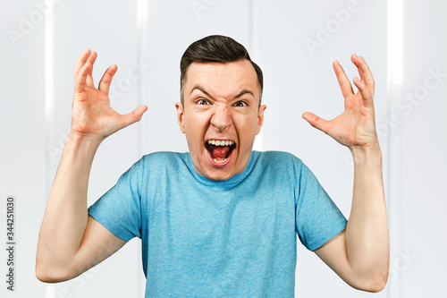 Stress, anger and despair guy screaming, crying and raising arms Wallpaper Mural