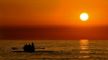 Sunset With Fishermen Going To...