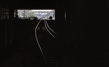 Railroad Track Leading Towards Tunnel