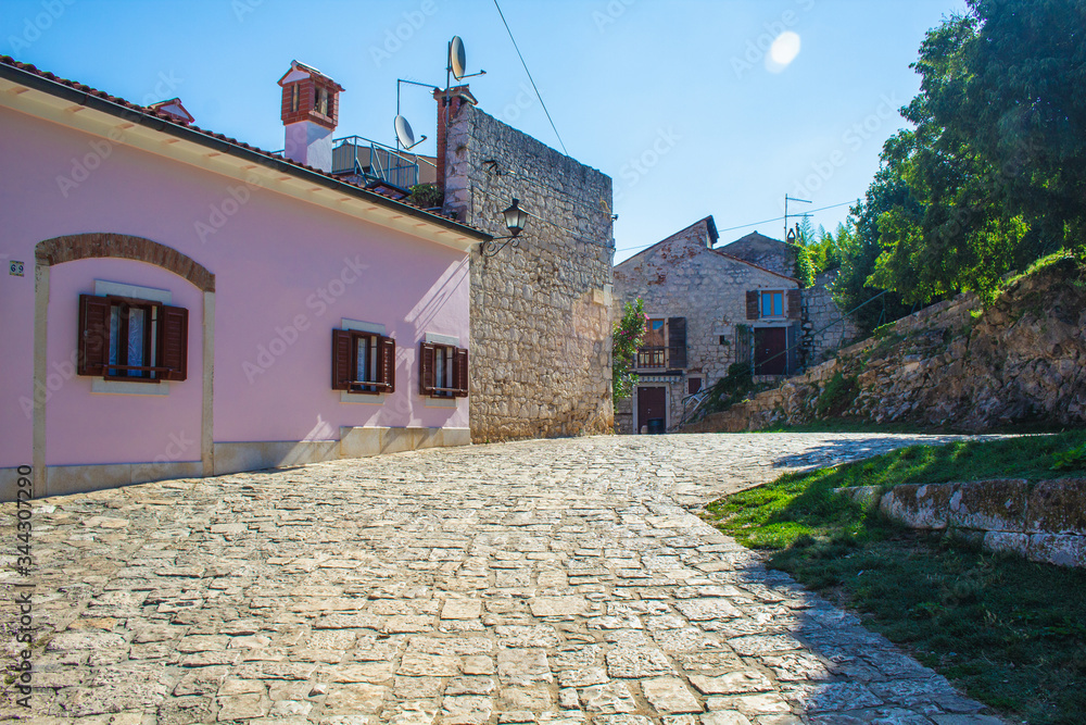 Empty street in the colorful old town of Rovinj, Istrian Peninsula in Croatia. The town is a popular tourist destination in summer