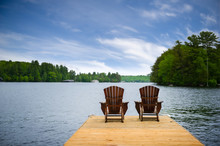 Two Adirondack Chairs On A Woo...