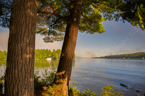 Early morning on the lake, misty landscape in cottage country Canvas Print