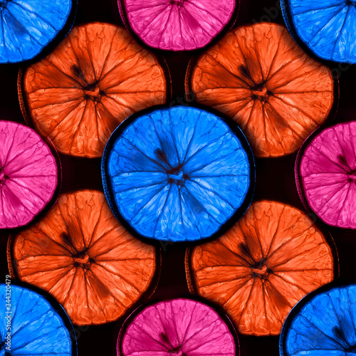 seamless pattern of slices of multicolor citrus fruit with backlight isolated on Canvas Print