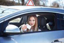 Joyful Girl Driving A Training...
