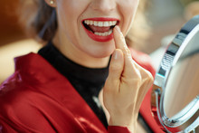 Trendy Woman Looking In Mirror And Checking Teeth