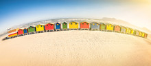 Multi Colored Huts At Beach Against Sky