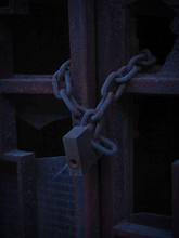 Close-up Of Rusty Chain Locked...