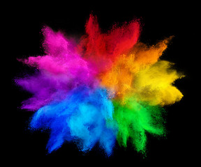 colorful rainbow holi paint color powder explosion isolated on dark black background. peace rgb gaming beautiful party concept