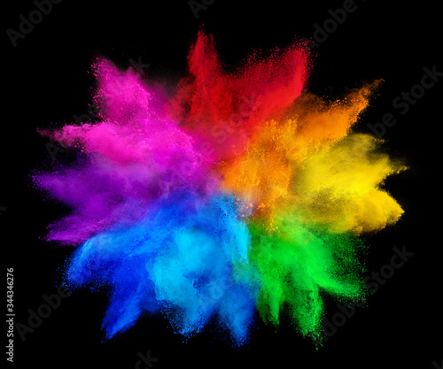 Obraz colorful rainbow holi paint color powder explosion isolated on dark black background. peace rgb gaming beautiful party concept - fototapety do salonu