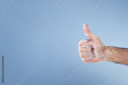 Fotografie, Tablou Hand with soap suds making the OK gesture.